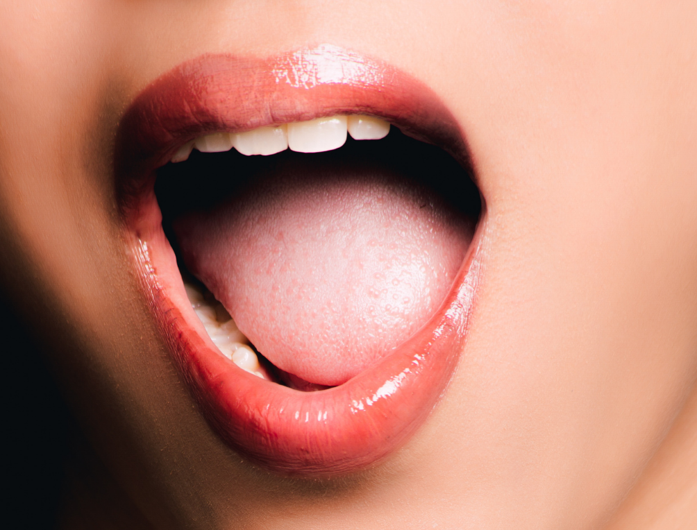 open mouth to look for signs of oral cancer